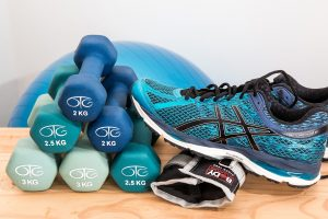 dumbbells and sneaker for physical therapy